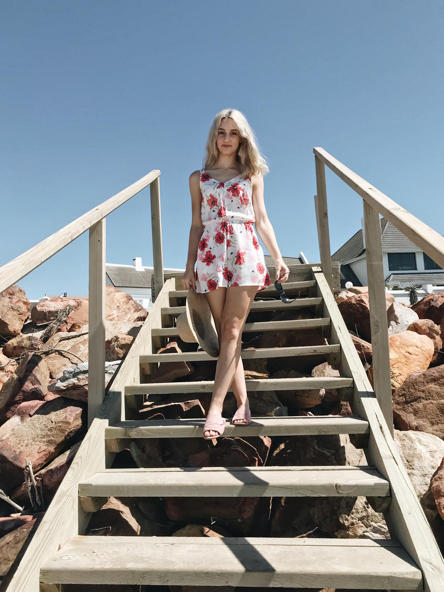 Lauren Carmen standing on the beach steps
