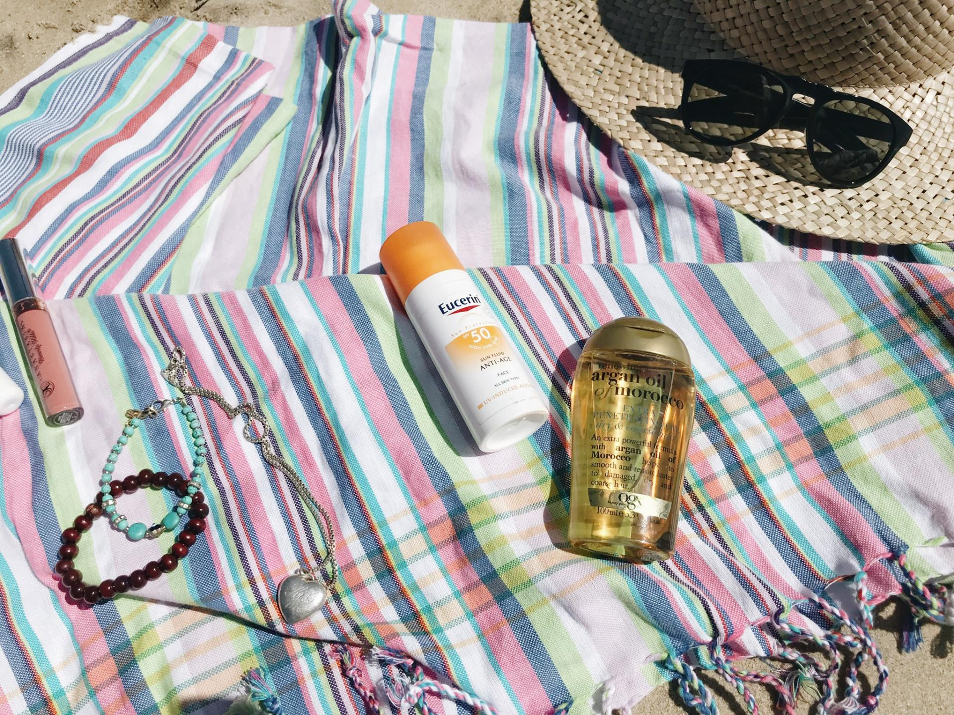 Close up of the sunscreen and argan oil