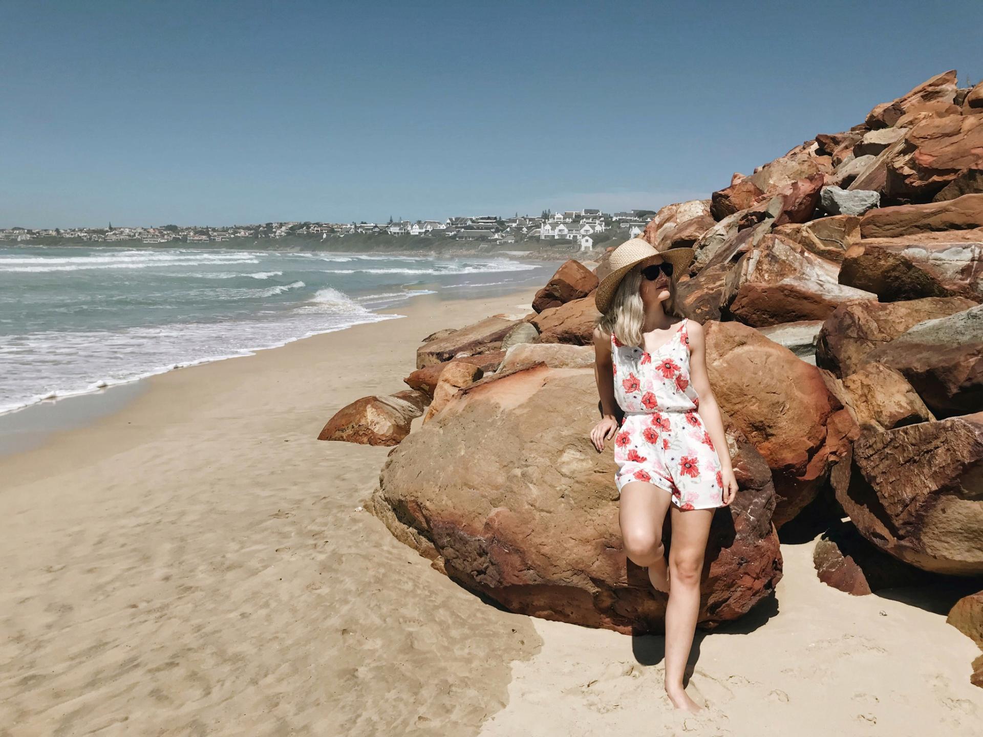 Lauren Carmen leans on the rocks behind her